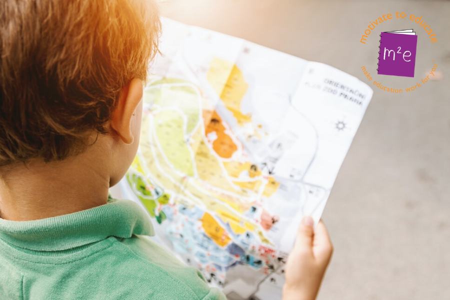 Young boy looking at a map